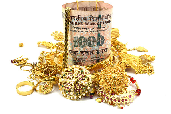 Indian currency and Gold Jewelry