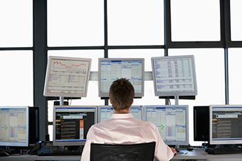 Businessmen-Watching-Data-on-Flat-Panel-Monitors