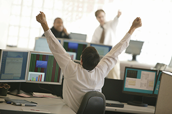 Stock traders celebrating