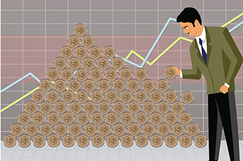 Businessman arranging money to make a money pyramid